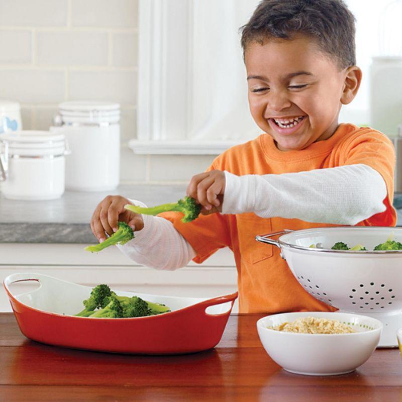 Boy cooking brocolis