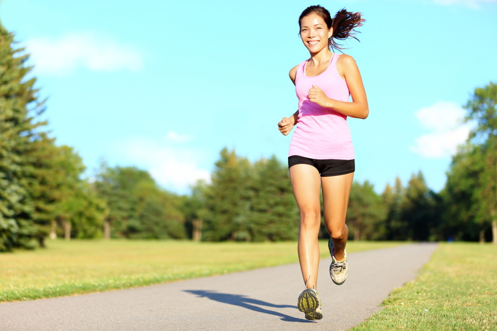 Woman running happily
