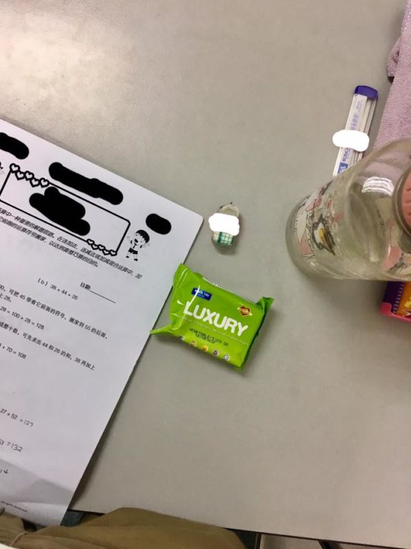Biscuit pack next to a student work
