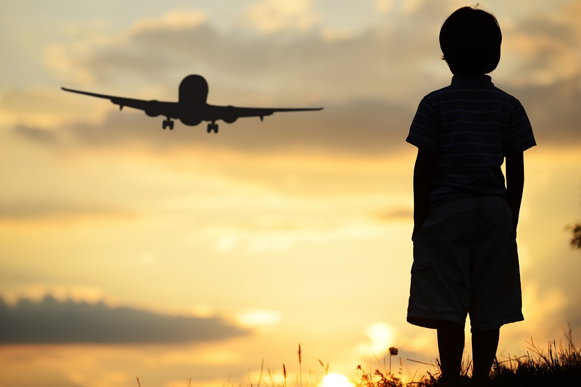 Kid looking for a plane