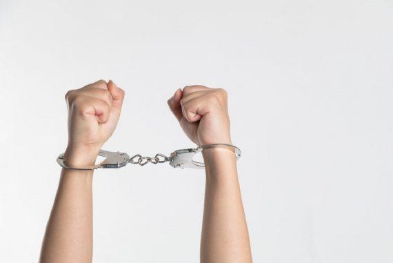 handcuffed man