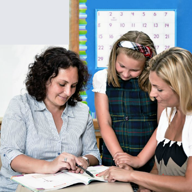 Parent discuss with teacher about kids' maths education