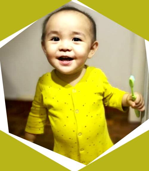 Dylan Yong loves brushing his eight baby teeth. (Image Credit: Jo Lee)