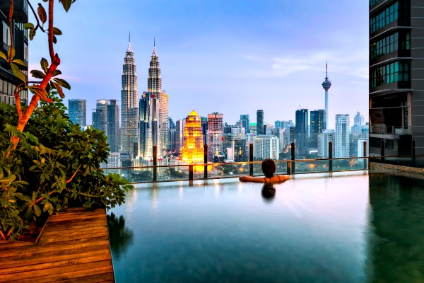 An infinity pool overlooking KLCC. Buy or Rent? A Housing Dilemma for Families in Malaysia