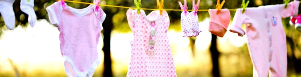 Baby clothes hanging on a line.