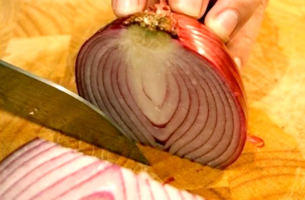 Cutting an onion. Peel Shallots, Onions, Ginger, Turmeric faster than you can say Save Time In The Kitchen