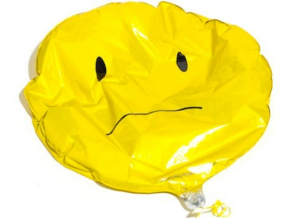 Deflated yellow balloon. 7 Things Nobody Tells You When You Stop Breastfeeding