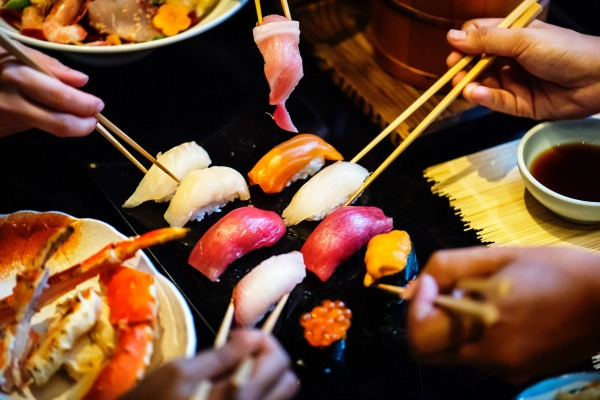 Many people eating a sushi meal. 7 Things Nobody Tells You When You Stop Breastfeeding