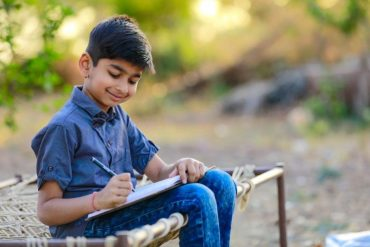 indian kid write journal