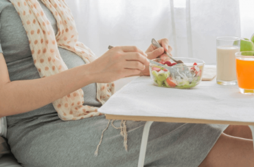 pregnant eating fruit salads