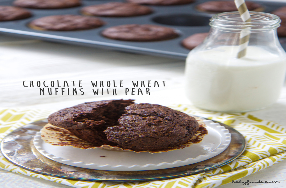 Muffins on a plate with a glass of milk