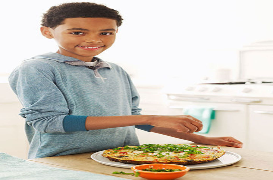 boy with a plate of pizza