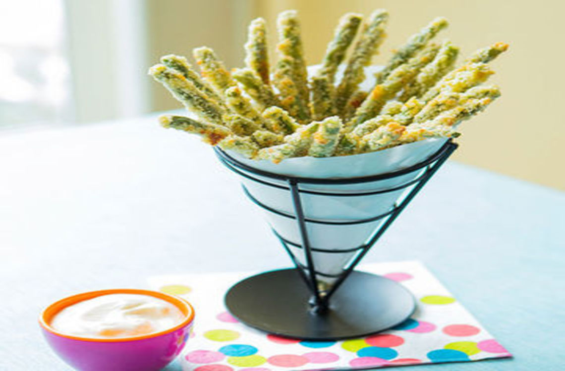 cone of green bean fries with a dip on the side