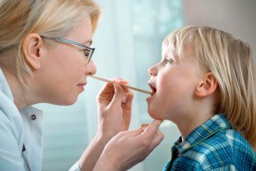 doc-check-tonsils-kid